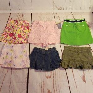 Bundle of girls skirts/skorts sz4/4t